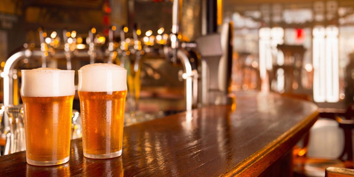 two draft beers on bar top - liquor liability restaurant insurance park ridge nj